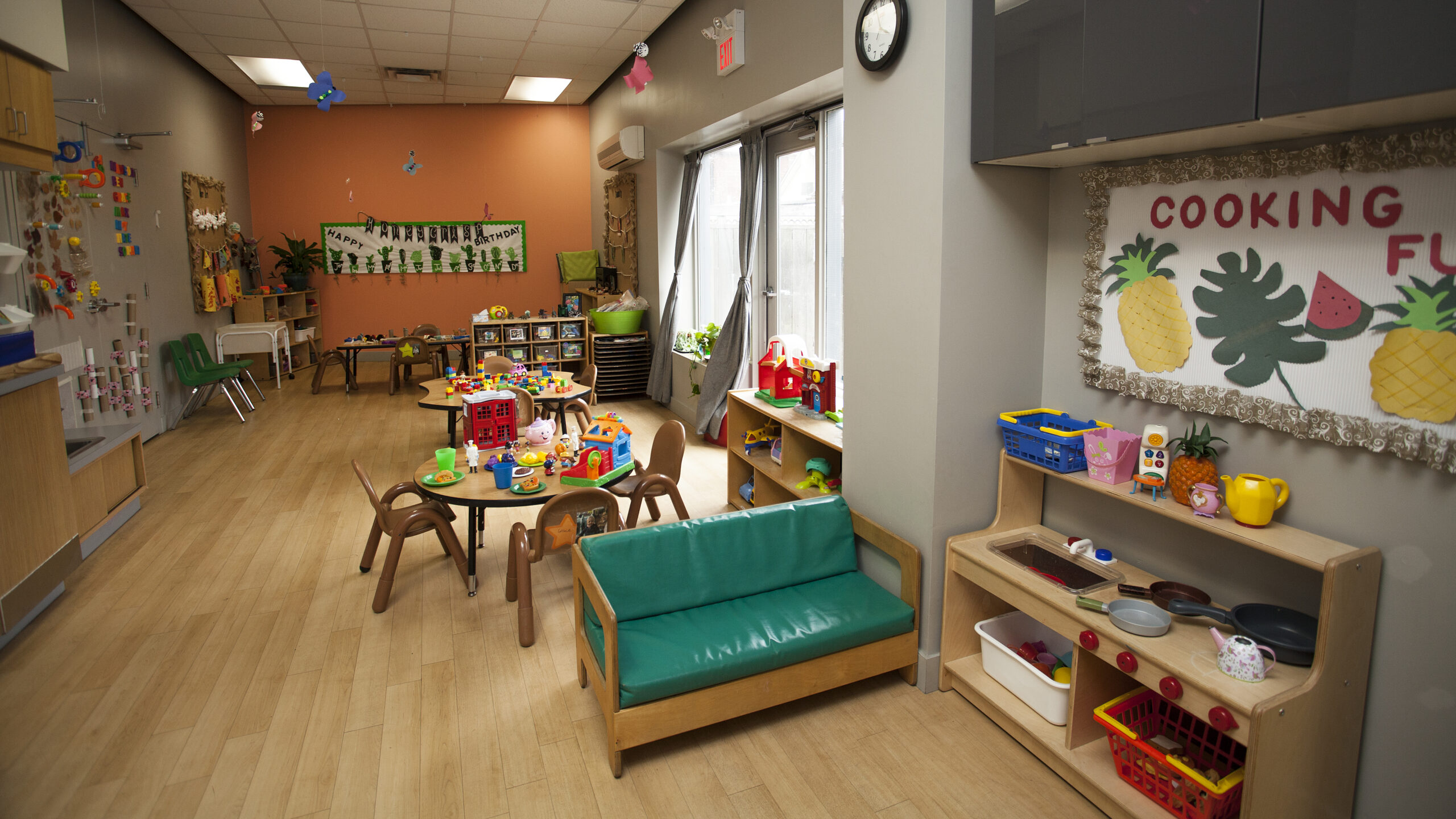 toddler room with toys and tables