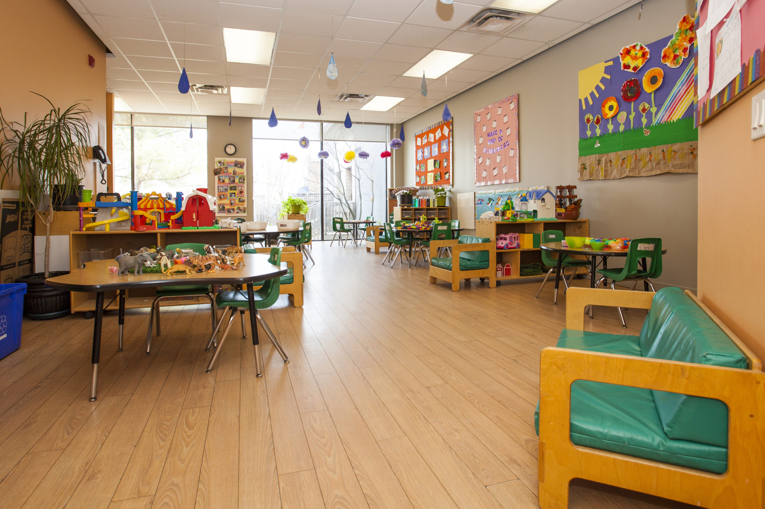 preschool classroom with tables and couches