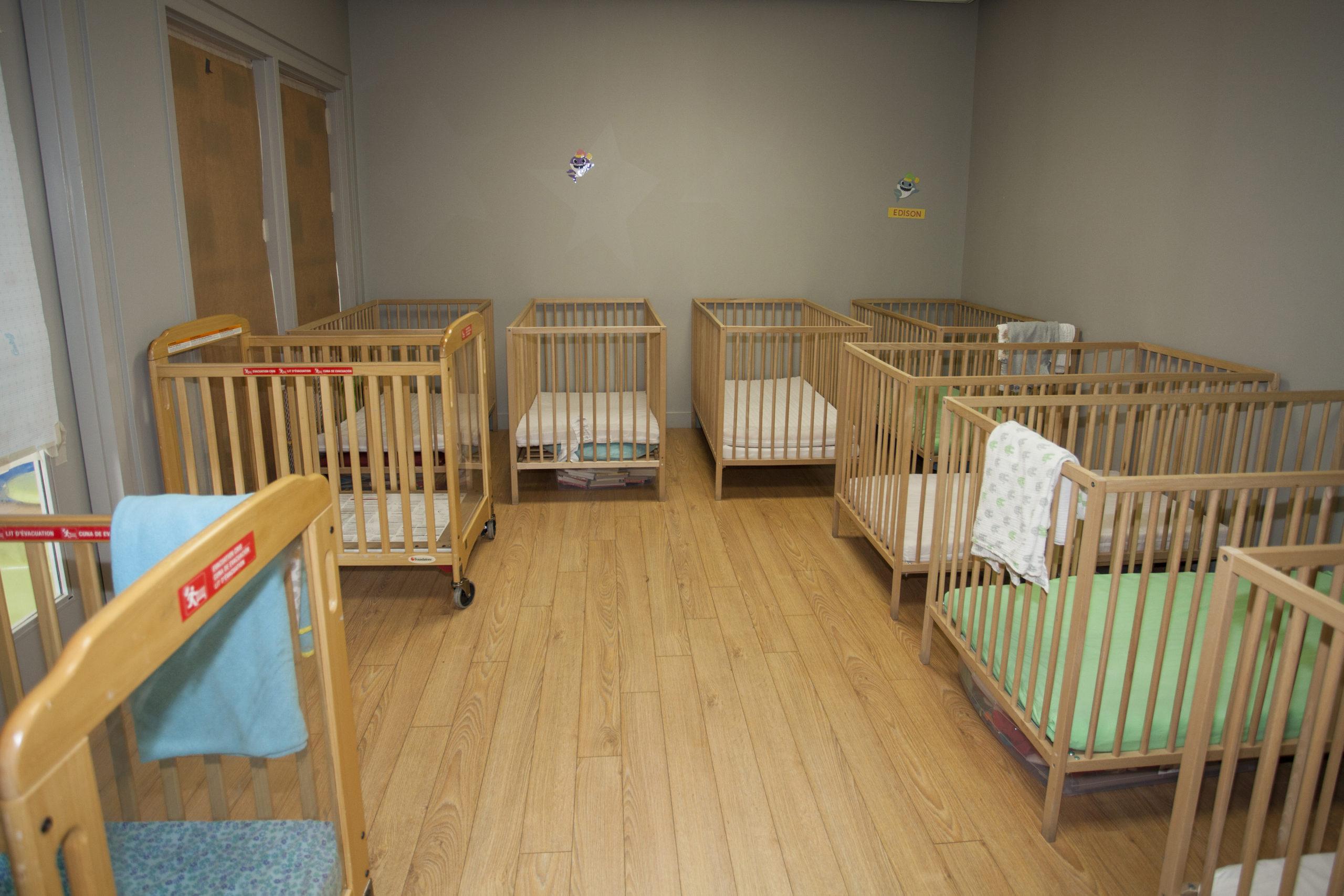 infant sleep room with cribs