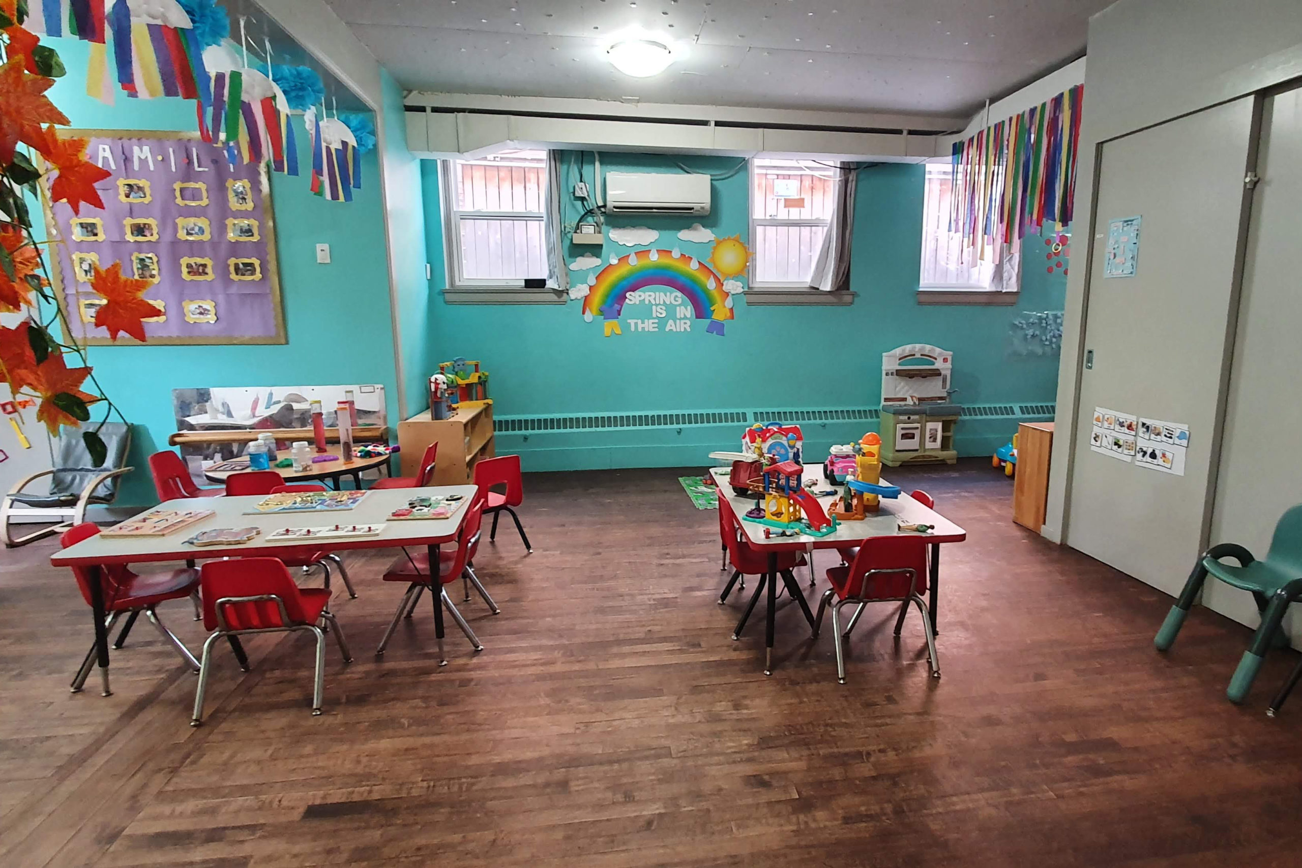 toddler classroom with tables and toys