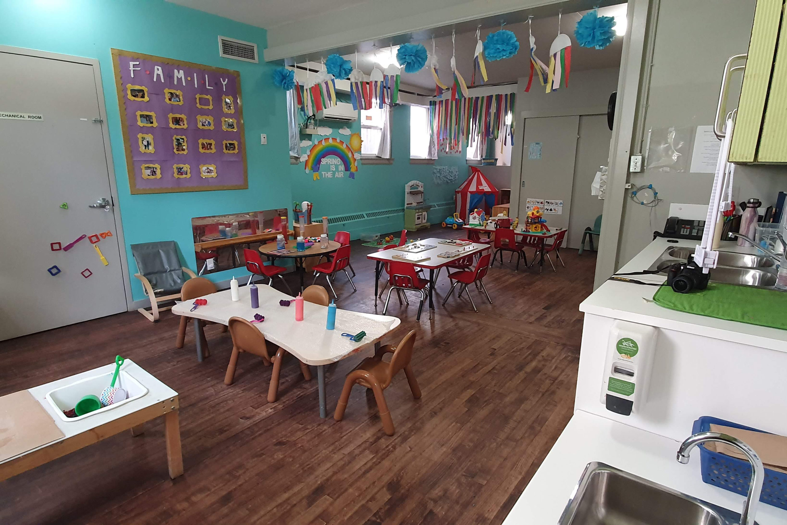 toddler classroom with tables and chairs