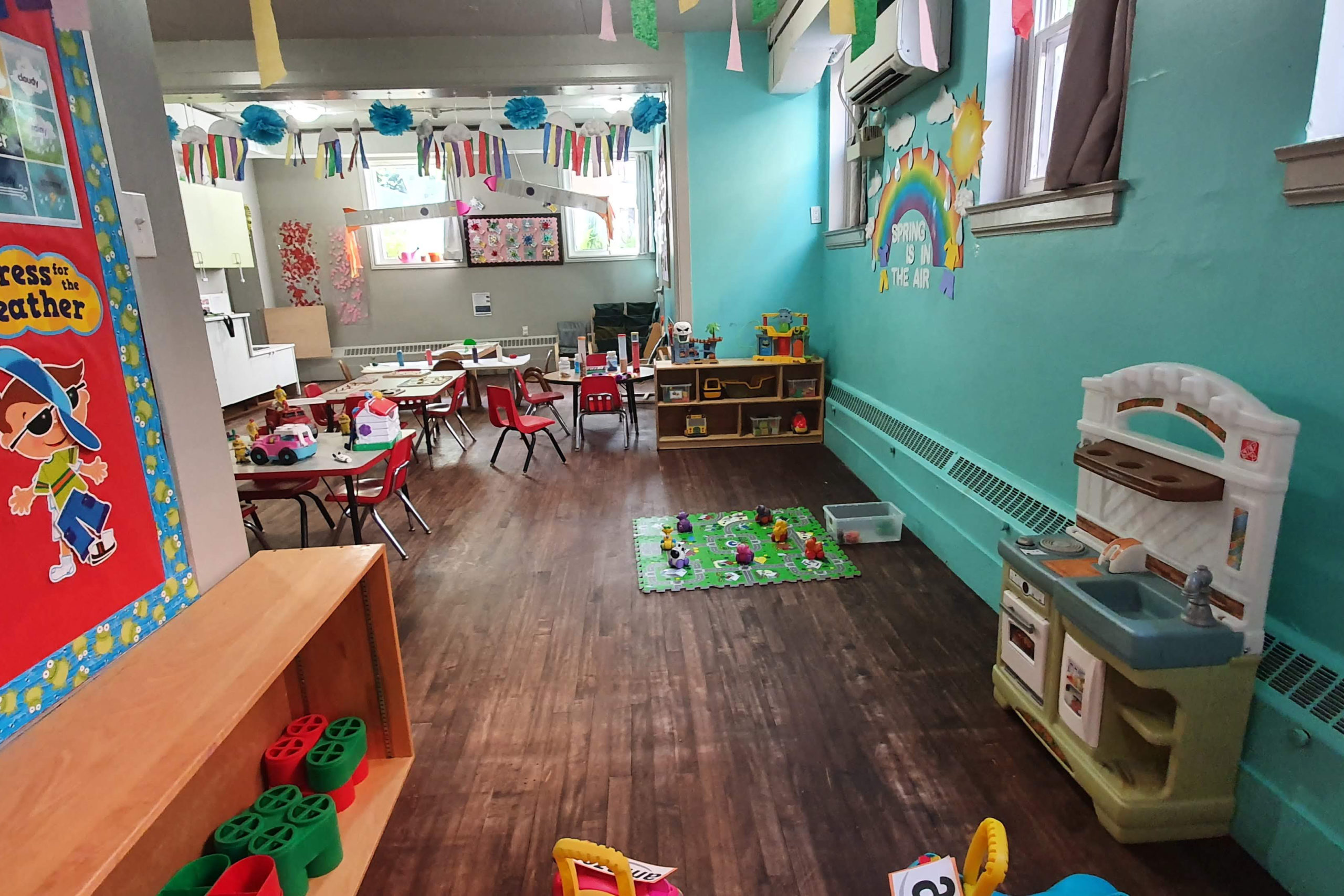 toddler room with tables and toys