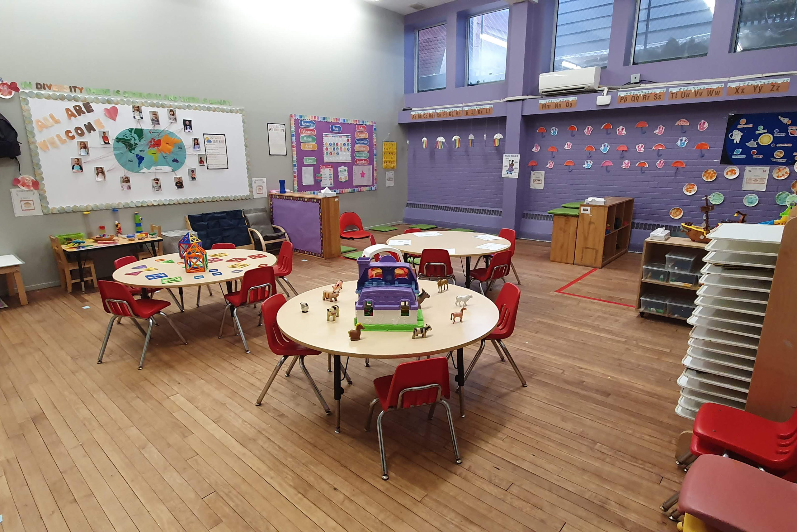 preschool room with tables and toys